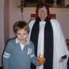 Pictured with his finished Christingle is Oliver Baggott (age 9) with Rev'd Fliss Iliffe.