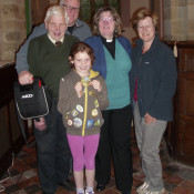 "Pictured are FRONT - Lydia Baggott (8) with her Brownie ""Good Deed"" badge MIDDLE - Mr George Poyner, Rev'd Val Smith and Mrs Mary Nelson BACK - Paul Stedman"